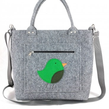 Green bird on pocket/strap
